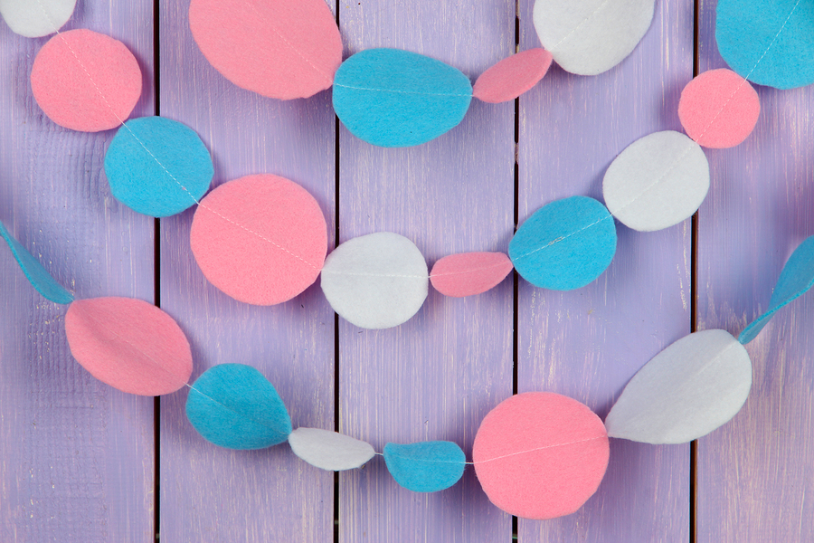Decorative felt garland on wooden background