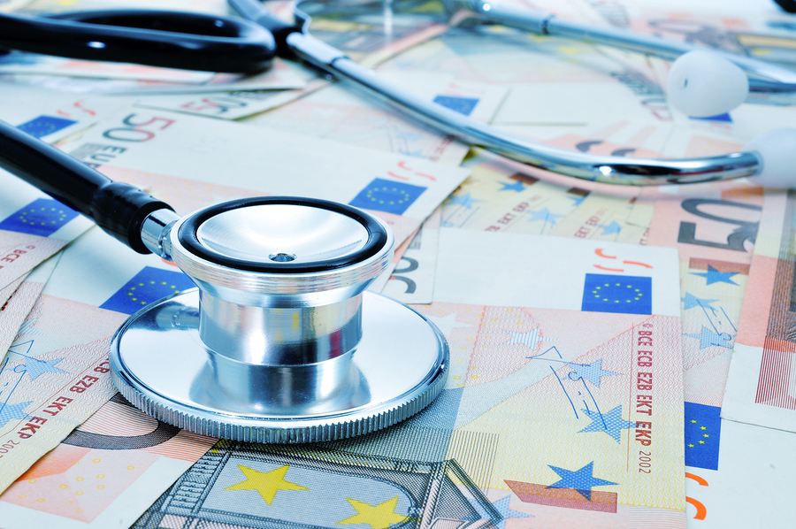 a stethoscope on a pile of euro bills, depicting the health care