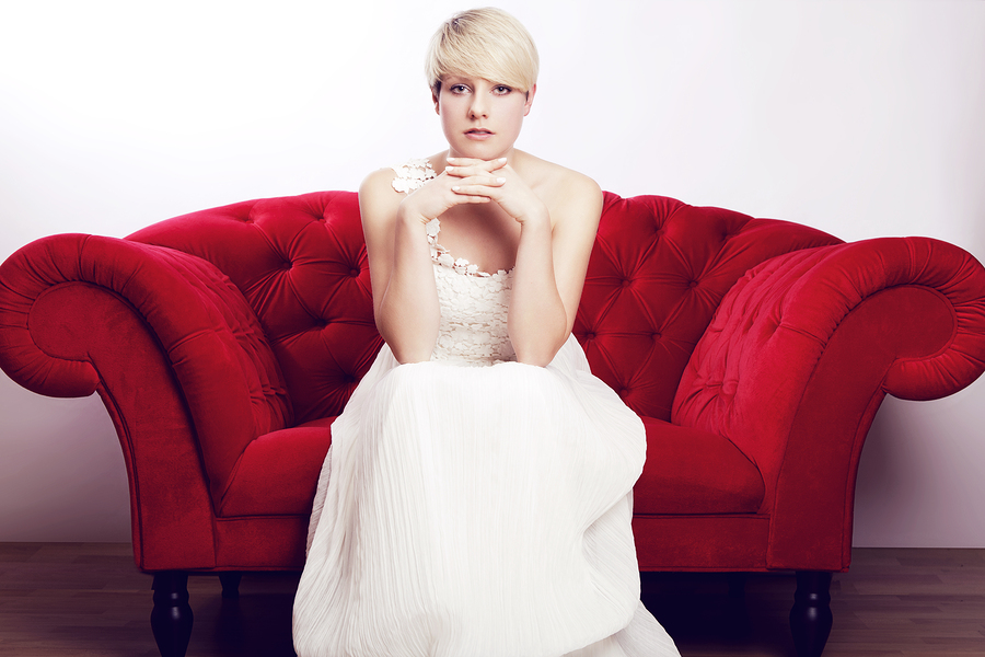 young short haired blonde girl with bridal dress